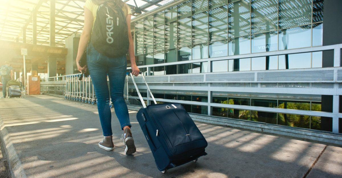 Woman with Luggage travel insurance